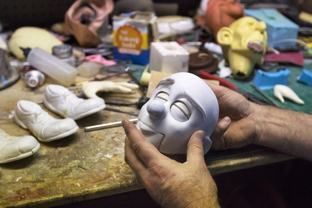 Scott Land, master puppeteer and owner of Team Land Productions works on the facial details of an unfinished marionette at his company's warehouse in Las Vegas on Wednesday, Feb. 1, 2017. (Miranda ...