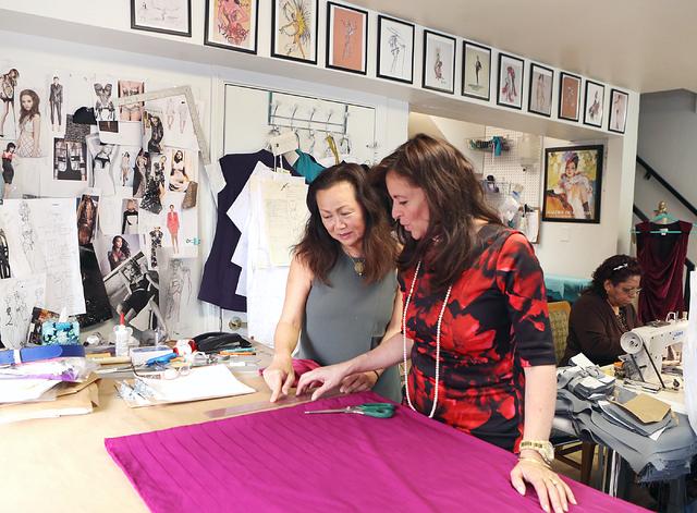 Catharine Trifiletti, right, a uniform designer, in her design studio with her assistant Helen Costello on 618 Las Vegas Blvd. South on Friday, Feb. 12, 2017, in Las Vegas. (Bizuayehu Tesfaye/Las  ...