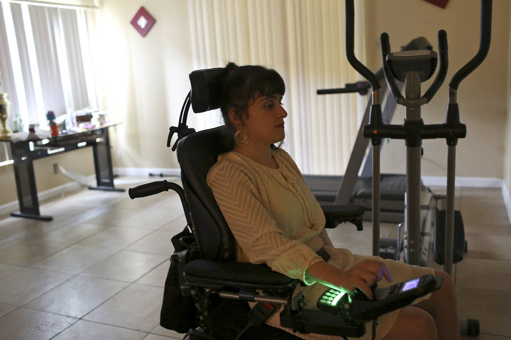 Sharona Dagani crosses the living room at her home in San Antonio, Texas on Sunday, March 12, 2017. The 29-year-old, Dagani, born with cerebral palsy, is one of hundreds of former clients whose fu ...