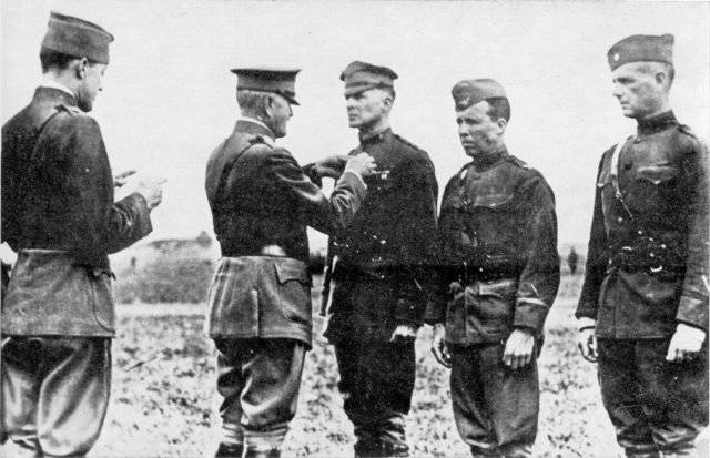 General John J. Pershing, second from left, pins Brig. Gen. Douglas MacArthur with Distinguished Service Cross in 1918. Charles T. Menoher, left, reads citation. Leach, fourth from left, and Willi ...