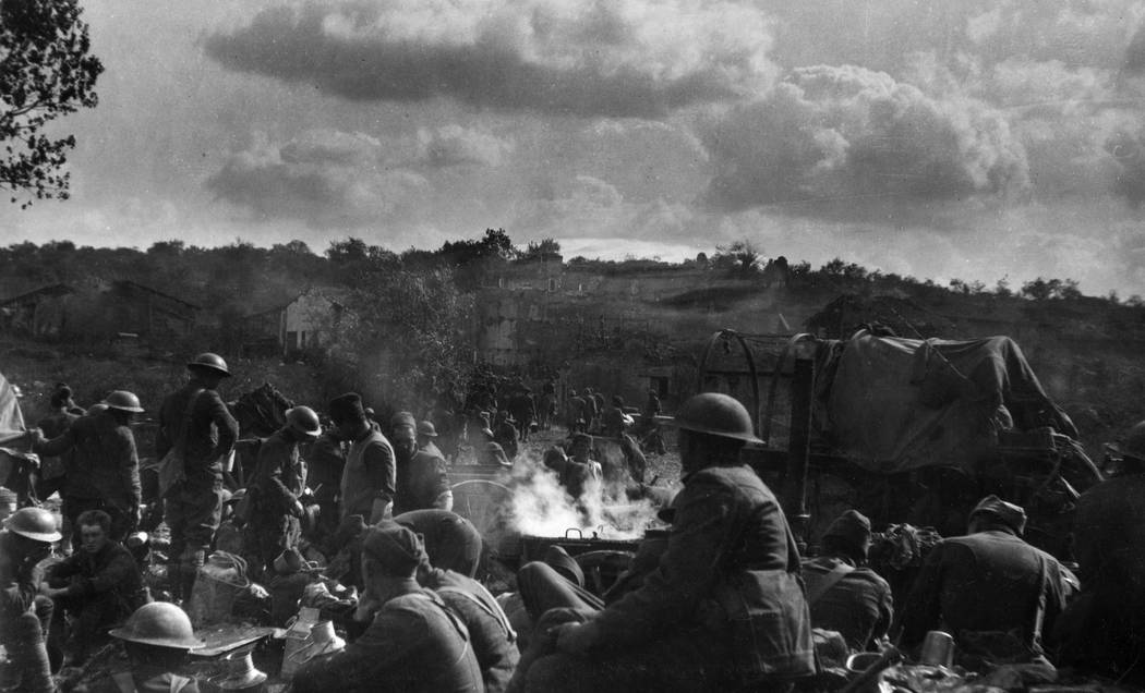 Members of the U.S. Army 91st Division during a respite in the Argonne-Meuse offense near Very, France in 1918. Shells were falling constantly and German aircraft flying low overhead. Harry A. Wil ...