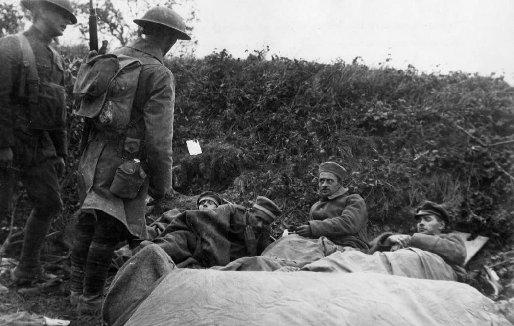 Members of the U.S. Army 91st Division guarding slightly wounded German prisoners captured near Cheppy, France, during final offense of World War l. Harry A. Williams/ Los Angeles Times