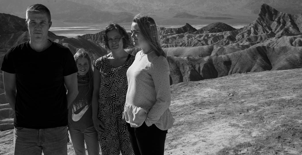 """A family from Denmark strikes the same pose as Irish rock band U2 did on the cover of its 1987 album """"The Joshua Tree,"""" taken at Zabriskie Point, shown in the background, at Death Valley National  ..."""