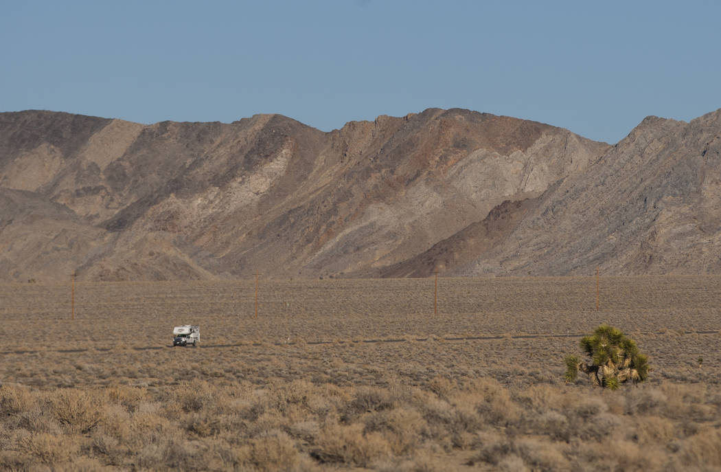 "An RV drives along California State Route 190 outside of Death Valley National Park, seen from the area of the remains of the tree featured in the album artwork of U2's 1987 album ""The Jo ..."
