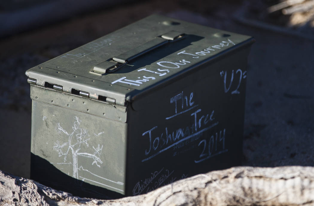"""The remains of the tree featured in the album artwork of U2's 1987 album """"The Joshua Tree"""" is shown with tributes and memorabilia outside of Death Valley National Park along Cali ..."""