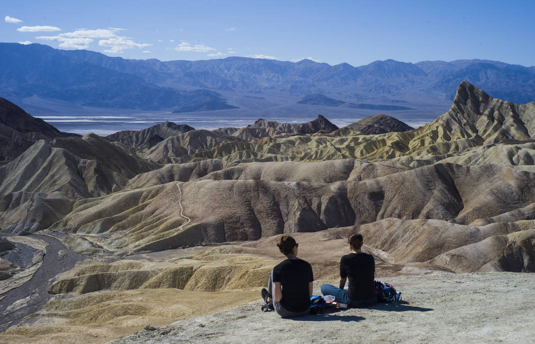 "People at Zabriskie Point in Death Valley National Park on Tuesday, Feb. 28, 2017. The cover art of rock band U2's ""The Joshua Tree"" was taken at the popular tourist spot at the  ..."