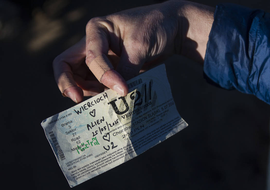 """An old concert ticket left by fans of rock band U2 sits with the fallen tree that appeared in the band's 1987 album """"The Joshua Tree"""" outside of Death Valley National Park along  ..."""