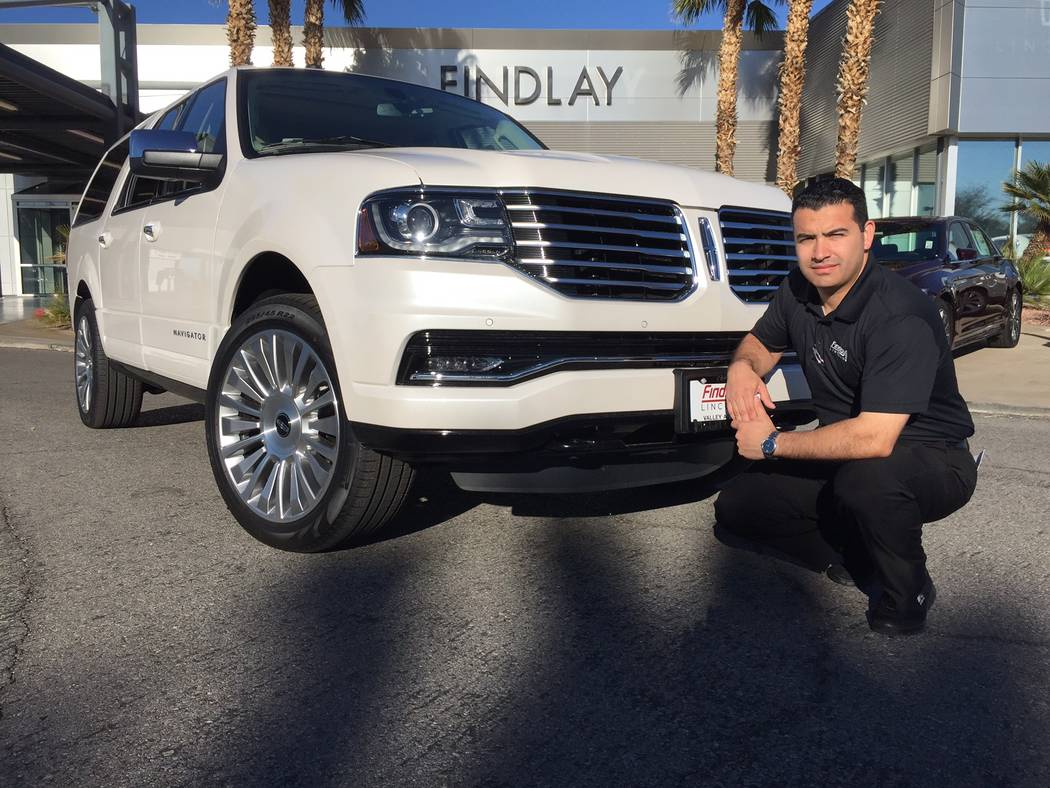 COURTESY Findlay Lincoln sales consultant Frank Luciano is seen with the 2017 Lincoln Navigator sport utility vehicle at the dealership situated at 310 N. Gibson Road in the Valley Automall.