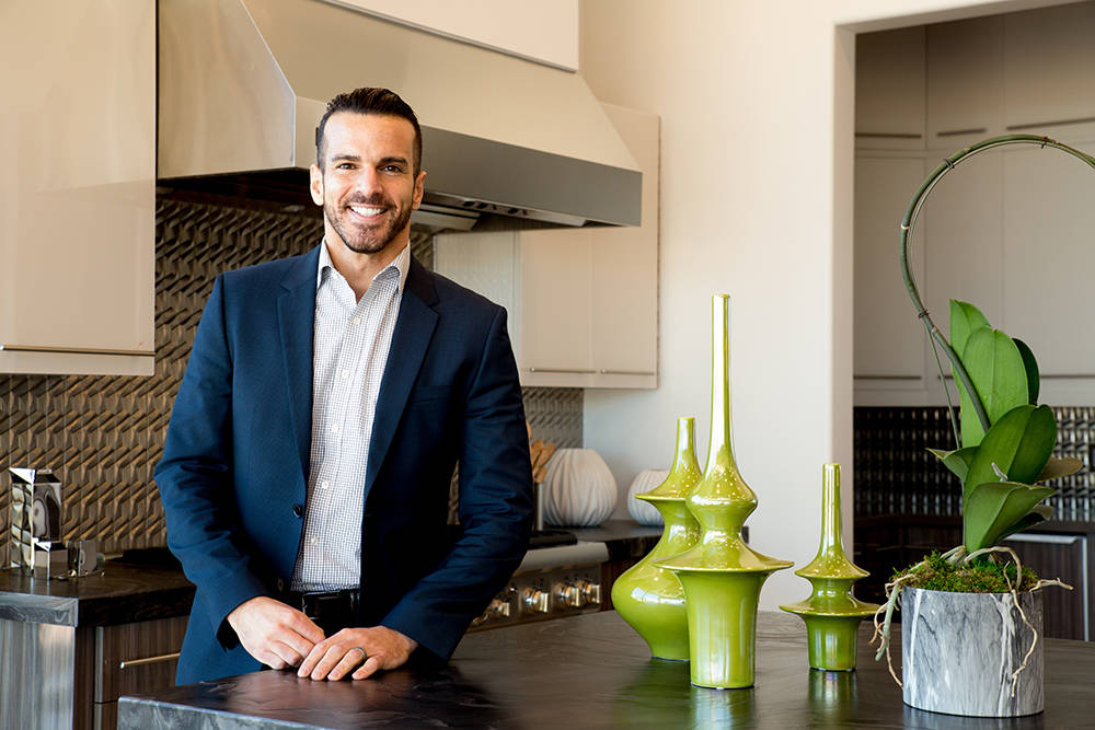 TONYA HARVEY/REAL ESTATE MILLIONS  Avi Dan-Goor, a real estate sales executive with Berkshire Hathaway HomeServices, works with designer Christopher Todd to stage luxury homes for sale in the Las  ...