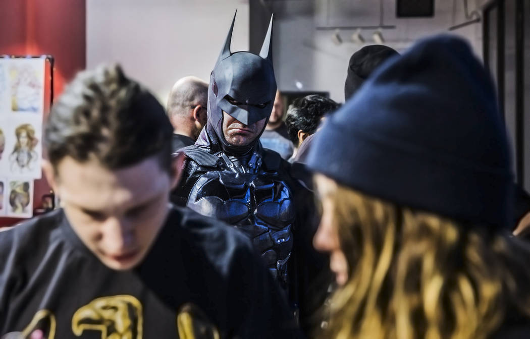 Cody Strohl, dressed as Batman, interacts with guests during a fundraising event to support local nonprofit Critical Care Comics on Thursday, March 17, 2017, at Village Square, in Las Vegas. Criti ...