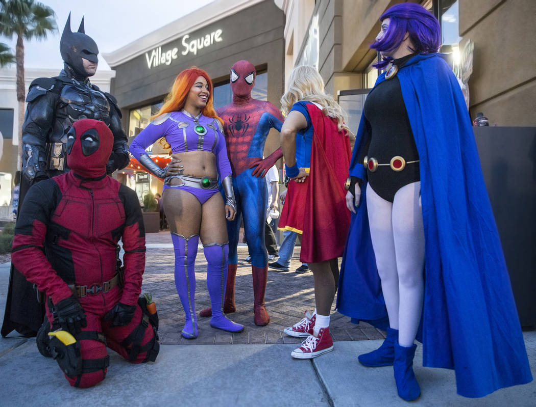 Volunteers dressed as superheroes wait to greet guests during a fundraising event to support local nonprofit Critical Care Comics on Thursday, March 17, 2017, at Village Square, in Las Vegas. (Ben ...