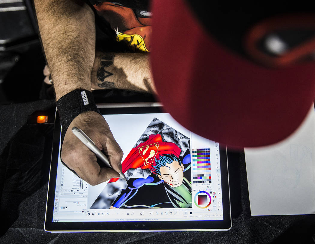 Chas Gallagher works on a digital sketch of Superman during a fundraising event to support local nonprofit Critical Care Comics on Thursday, March 17, 2017, at Village Square, in Las Vegas. Critic ...