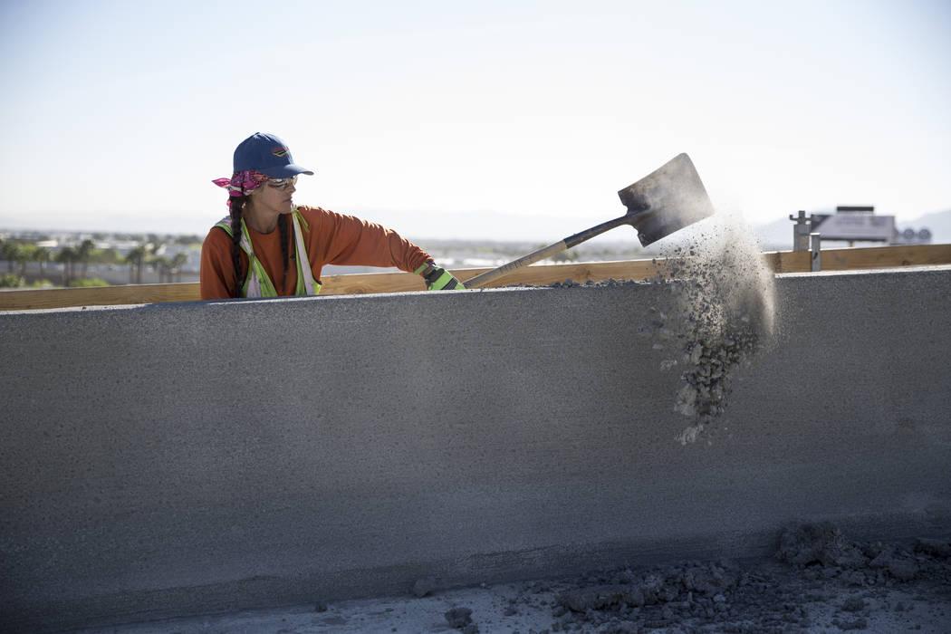 Nancy Carricarte removes debris at the McCarran Airport Connector construction project on Thursday, March 16, 2017, in Las Vegas. (Erik Verduzco/Las Vegas Review-Journal) @Erik_Verduzco