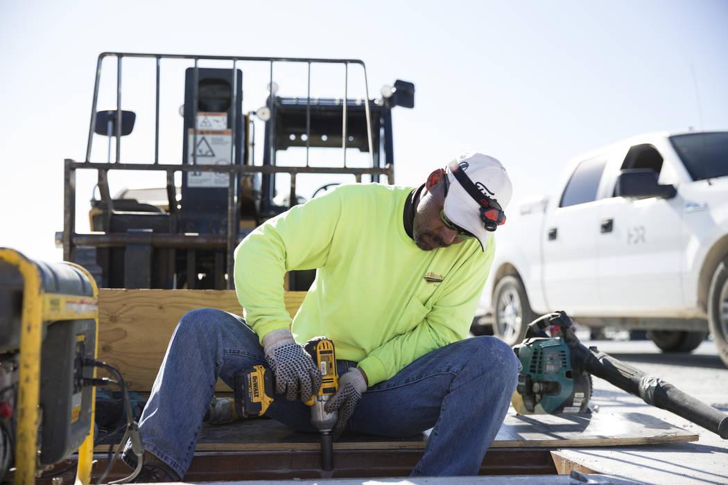 Bill Lewis drives a screw at the McCarran Airport Connector construction project on Thursday, March 16, 2017, in Las Vegas. (Erik Verduzco/Las Vegas Review-Journal) @Erik_Verduzco