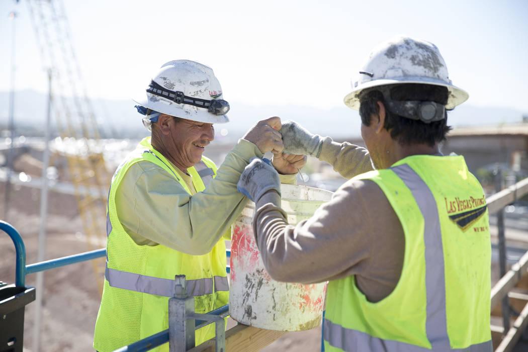 Jesus Vasquez, left, is assisted by Victor Castillo at the McCarran Airport Connector construction project on Thursday, March 16, 2017, in Las Vegas. (Erik Verduzco/Las Vegas Review-Journal) @Erik ...