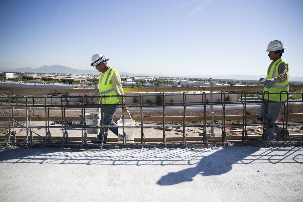Jesus Vasquez, left, and Victor Castillo carry materials at the McCarran Airport Connector construction project on Thursday, March 16, 2017, in Las Vegas. (Erik Verduzco/Las Vegas Review-Journal)  ...