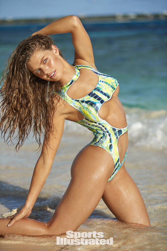 McKenna Berkley appears in body paint in the 2017 Sports Illustrated Swimsuit Issue. The body paint, done by a team of artists, is modeled after an actual swimsuit. (Josie Clough/Sports Illustrated)
