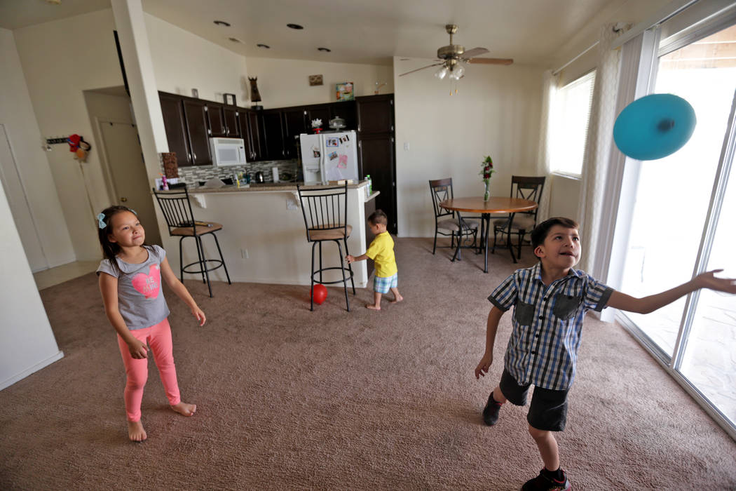 Aiden Chavez, 8, from left, her little brother Adrian Florence, 2, and her twin brother Abraham Chavez play with a balloon at their home on Sunday, March 19, 2017, in Las Vegas. Abraham recently h ...
