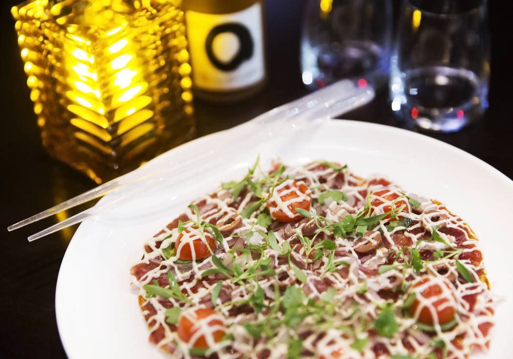 Tuna pizza, made with anchovy aioli, olives and jalapeno at Morimoto on Thursday, March 23, 2017, at the MGM Grand hotel/casino, in Las Vegas. (Benjamin Hager/Las Vegas Review-Journal) @benjaminhphoto