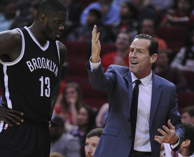 Brooklyn Nets head coach Kenny Atkinson gives instructions to Anthony Bennett (13) as they face the Houston Rockets in the first half of an NBA basketball game on Monday, Dec. 12, 2016, in Houston ...