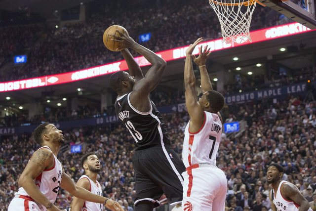 Brooklyn Nets forward Anthony Bennett (13) shoots on Toronto Raptors guard Kyle Lowry during first half NBA basketball action in Toronto on Tuesday, Dec. 20, 2016. (Chris Young/The Canadian Press  ...