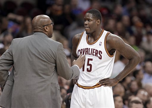 Cleveland Cavaliers coach Mike Brown, left, talks to Anthony Bennett during the third quarter of a game against the San Antonio Spurs on March 4, 2014, in Cleveland. (Mark Duncan/AP)