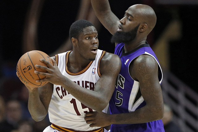 Cleveland Cavaliers' Anthony Bennett, left, tries to get past Sacramento Kings' Quincy Acy during the third quarter of an NBA basketball game Tuesday, Feb. 11, 2014, in Cleveland. Bennett scored 1 ...