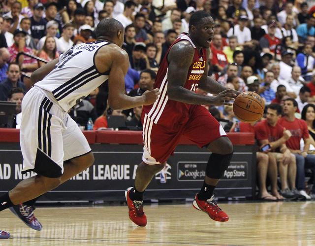 Cleveland's Anthony Bennett (15) drives past Milwaukee's  C.J. Williams (21) during their NBA Summer League game at the Cox Pavilion in Las Vegas on Friday, July 11, 2014. (Jason Bean/Las Vegas Re ...