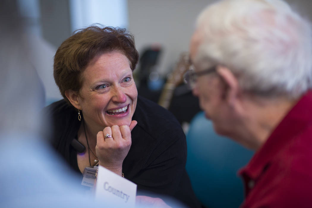 Music therapist Becky Wellman talks with Sandy during a group session for patients with memory and movement disorders at the Cleveland Clinic Lou Ruvo Center for Brain Health in Las Vegas on Wedne ...