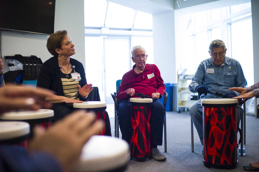 Music therapist Becky Wellman, left, leads a session for patients with memory and movement disorders at the Cleveland Clinic Lou Ruvo Center for Brain Health in Las Vegas on Wednesday, March 29, 2 ...