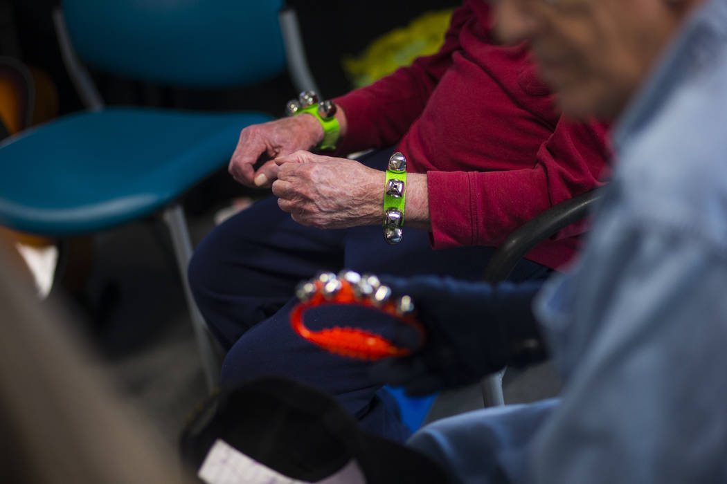 Patients with memory and movement disorders participate in a group music therapy session at the Cleveland Clinic Lou Ruvo Center for Brain Health in Las Vegas on Wednesday, March 29, 2017. (Chase  ...