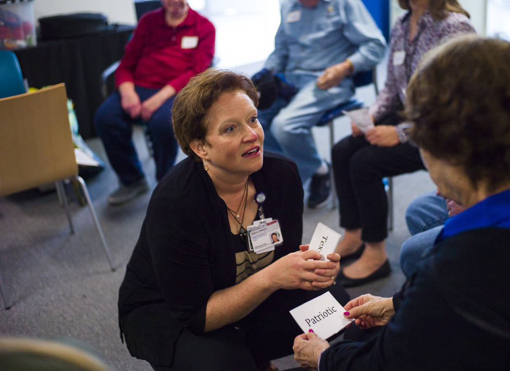 Music therapist Becky Wellman talks with Rebecca during a group session for patients with memory and movement disorders at the Cleveland Clinic Lou Ruvo Center for Brain Health in Las Vegas on Wed ...