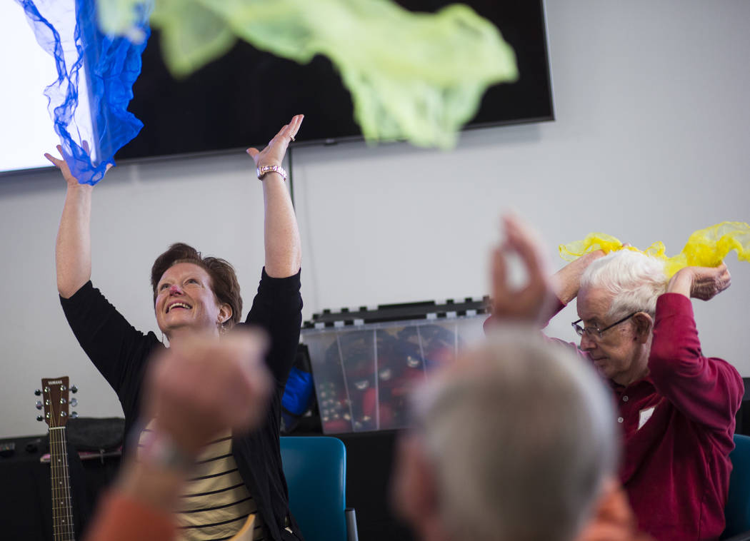Music therapist Becky Wellman, left, leads a class for patients with memory and movement disorders at the Cleveland Clinic Lou Ruvo Center for Brain Health in Las Vegas on Wednesday, March 29, 201 ...