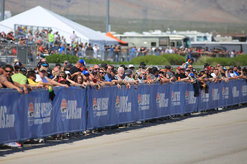 Fans watch Funny Car passes during the Denso Spark Plugs Nationals at The Strip at Las Vegas Motorspeedway in Las Vegas on Saturday, April 1, 2017. (Brett Le Blanc/Las Vegas Review-Journal) @blebl ...