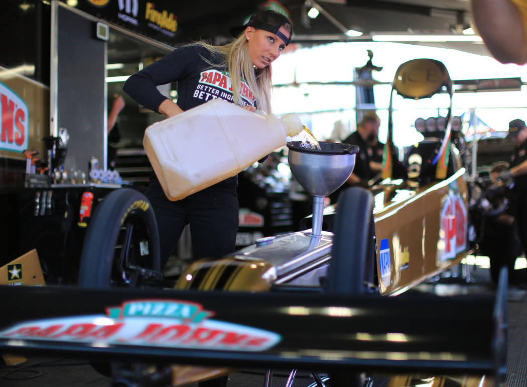 Top Fuel driver Leah Pritchett fuels her dragster before making a qualifying pass during the Denso Spark Plugs Nationals at The Strip at Las Vegas Motorspeedway in Las Vegas on Saturday, April 1,  ...