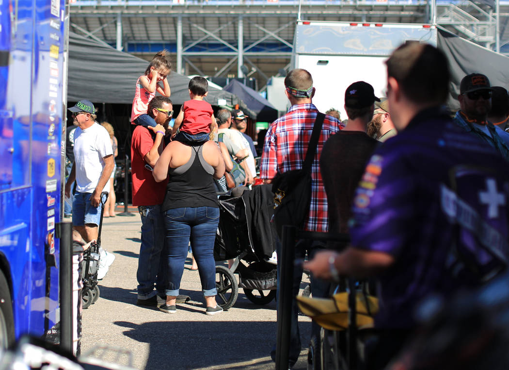 A young fan covers her ears as a dragster warms up in the pits during the Denso Spark Plugs Nationals at The Strip at Las Vegas Motorspeedway in Las Vegas on Saturday, April 1, 2017. (Brett Le Bla ...