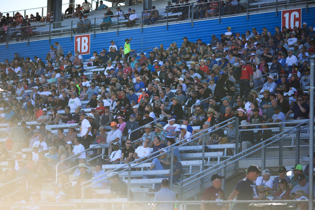 Fans watch Top Fuel passes during the Denso Spark Plugs Nationals at The Strip at Las Vegas Motorspeedway in Las Vegas on Saturday, April 1, 2017. (Brett Le Blanc/Las Vegas Review-Journal) @blebla ...
