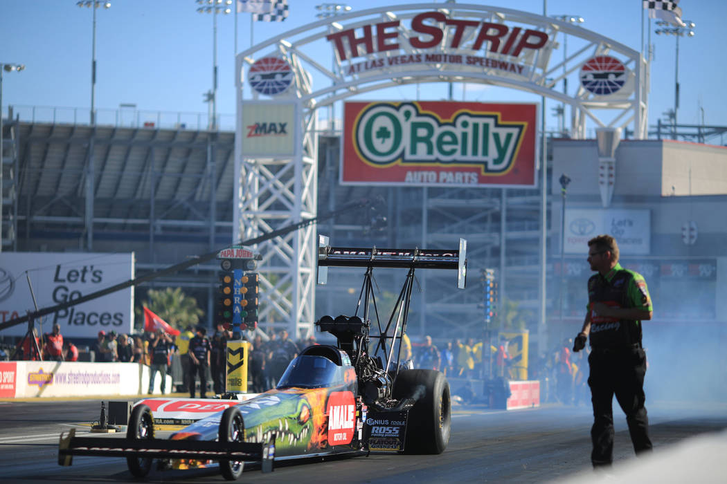 Top Fuel driver Terry McMillen backs his dragster up after performing a burnout during the Denso Spark Plugs Nationals at The Strip at Las Vegas Motorspeedway in Las Vegas on Saturday, April 1, 20 ...