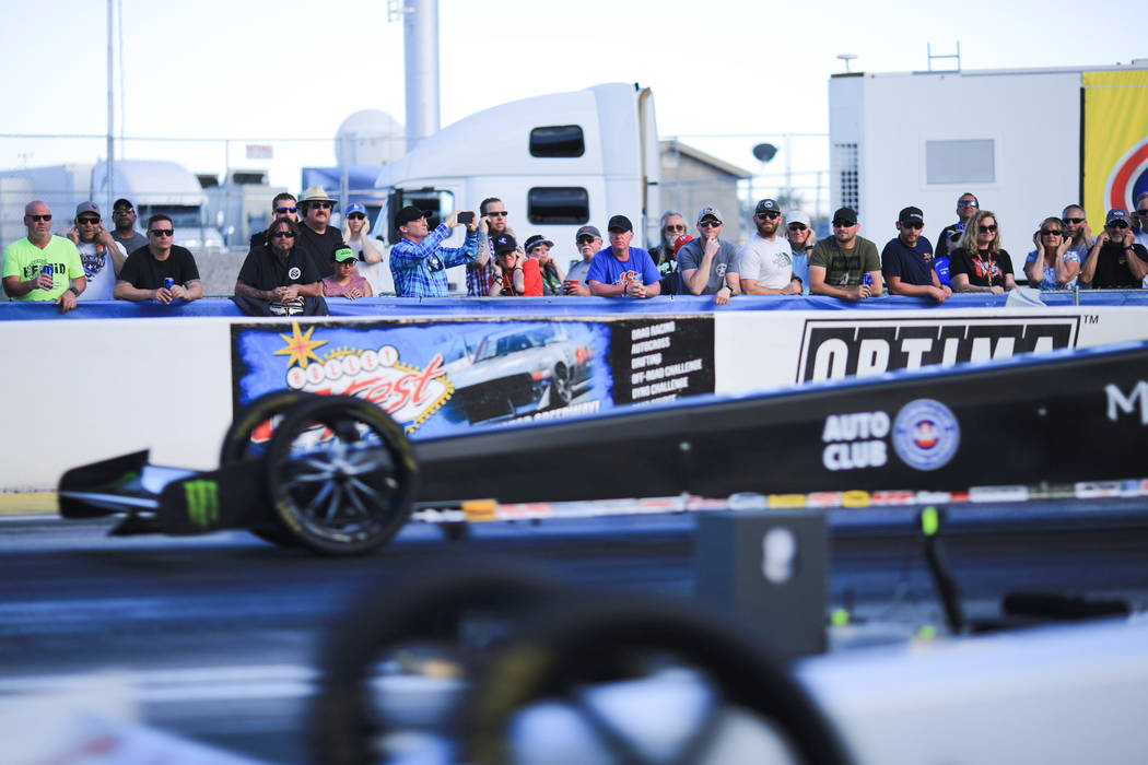 Fans watch as Top Fuel dragsters launch off the line during the Denso Spark Plugs Nationals at The Strip at Las Vegas Motorspeedway in Las Vegas on Saturday, April 1, 2017. (Brett Le Blanc/Las Veg ...