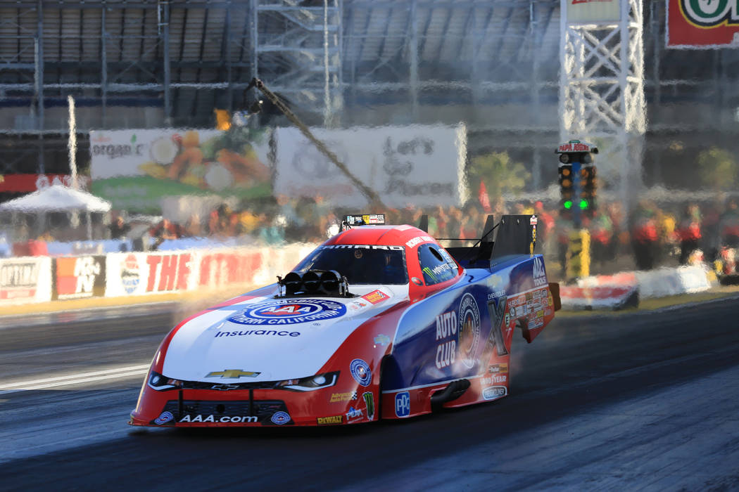 Funny Car driver Robert Hight makes a qualifying pass during the Denso Spark Plugs Nationals at The Strip at Las Vegas Motorspeedway in Las Vegas on Saturday, April 1, 2017. (Brett Le Blanc/Las Ve ...
