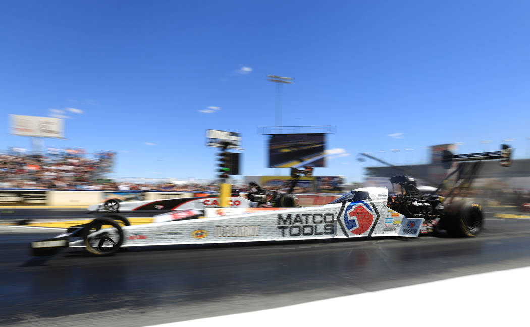 Top Fuel driver Antron Brown, near lane, makes a qualifying pass during the Denso Spark Plugs Nationals at The Strip at Las Vegas Motorspeedway in Las Vegas on Saturday, April 1, 2017. (Brett Le B ...