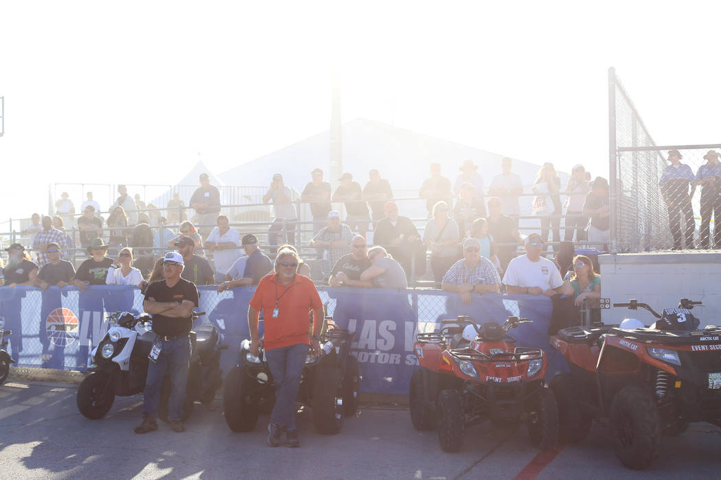 A cloud of tire smoke and unburnt nitromethane fuel obscures the crowd during the Denso Spark Plugs Nationals at The Strip at Las Vegas Motorspeedway in Las Vegas on Saturday, April 1, 2017. (Bret ...
