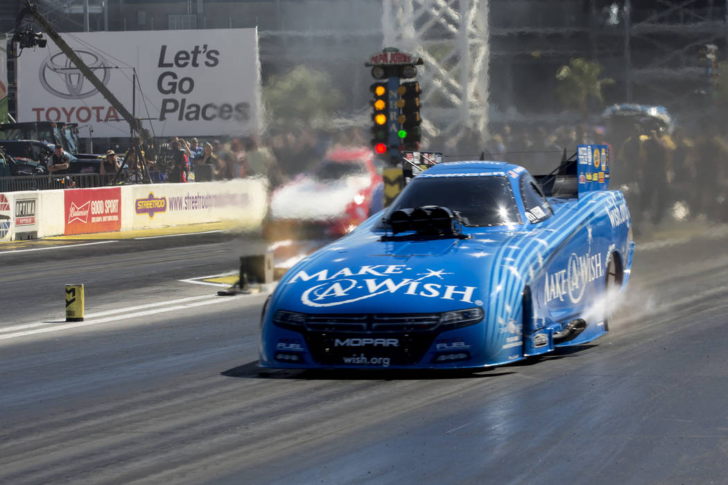 Funny Car driver Tommy Johnson Jr. races at The Strip at Las Vegas Motor Speedway on Sunday, April 2, 2017, in Las Vegas. Johnson Jr. was named the DENSO Spark Plugs NHRA Nationals Funny Car campi ...