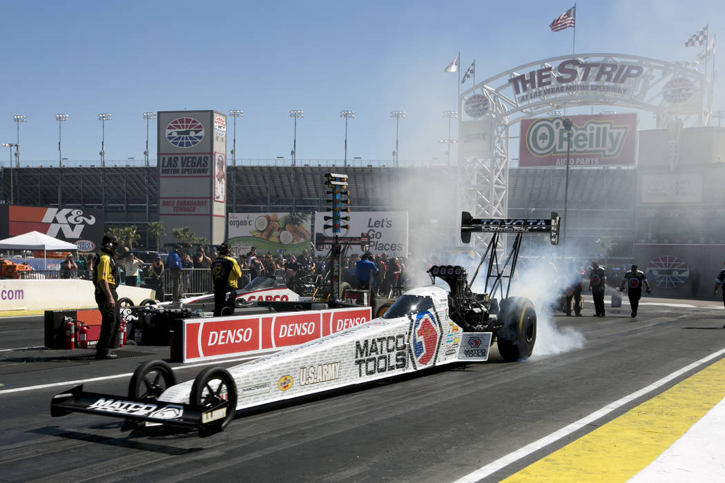 Top Fuel driver Antron Brown prepares to race at DENSO Spark Plugs NHRA Nationals at The Strip at Las Vegas Motor Speedway on Sunday, April 2, 2017, in Las Vegas. Brown was names the Top Fuel camp ...