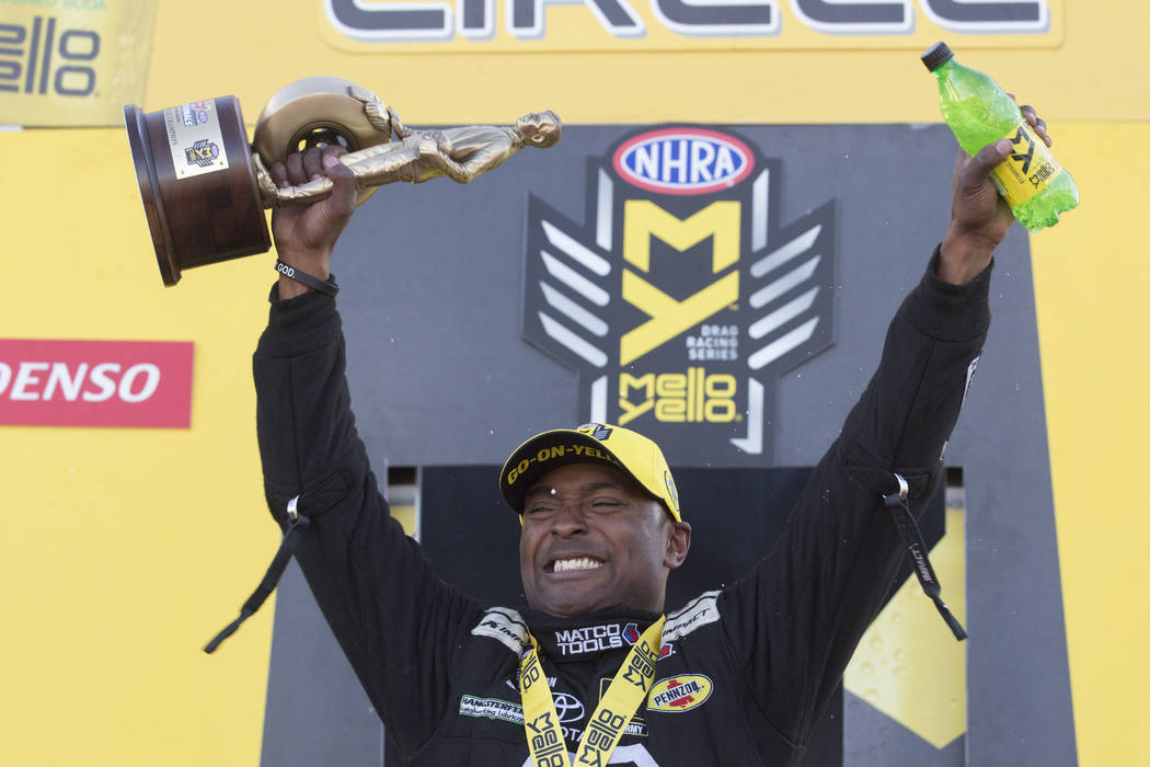 Top Fuel driver Antron Brown holds his trophy at the DENSO Spark Plugs NHRA Nationals at The Strip at Las Vegas Motor Speedway on Sunday, April 2, 2017, in Las Vegas. (Bridget Bennett/Las Vegas Re ...