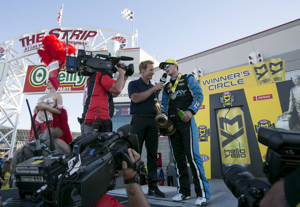 Pro Stock driver, 17-year-old Tanner Gray, holds his trophy as he speaks with media after his win at the DENSO Spark Plugs NHRA Nationals at The Strip at Las Vegas Motor Speedway on Sunday, April  ...