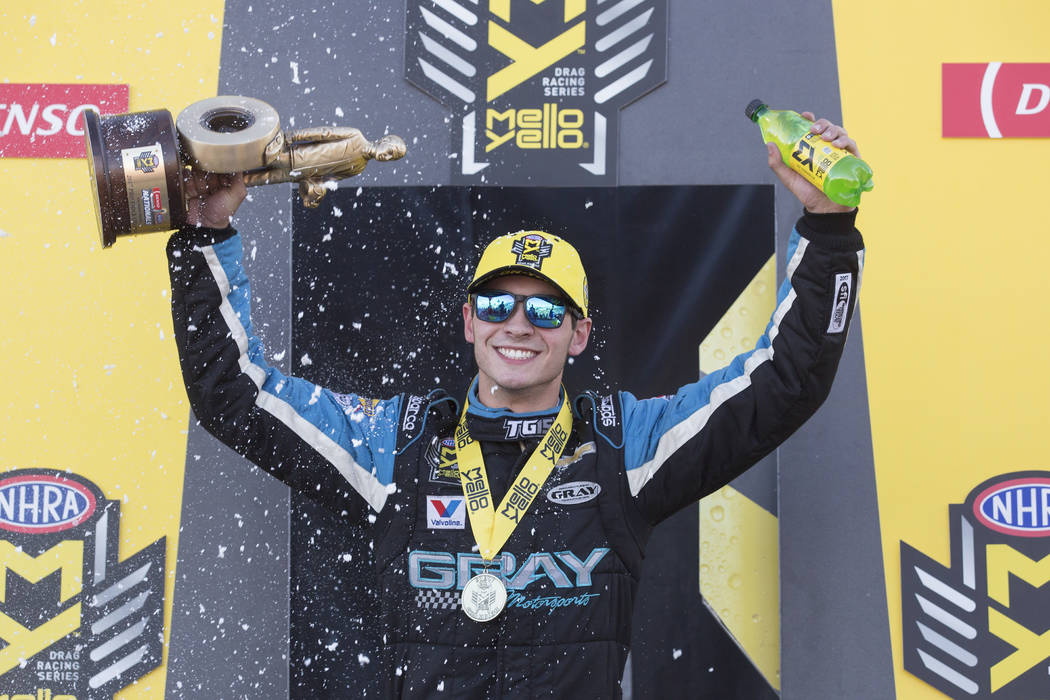 Pro Stock driver, 17-year-old Tanner Gray, holds up his trophy after his win at the DENSO Spark Plugs NHRA Nationals at The Strip at Las Vegas Motor Speedway on Sunday, April 2, 2017, in Las Vegas ...