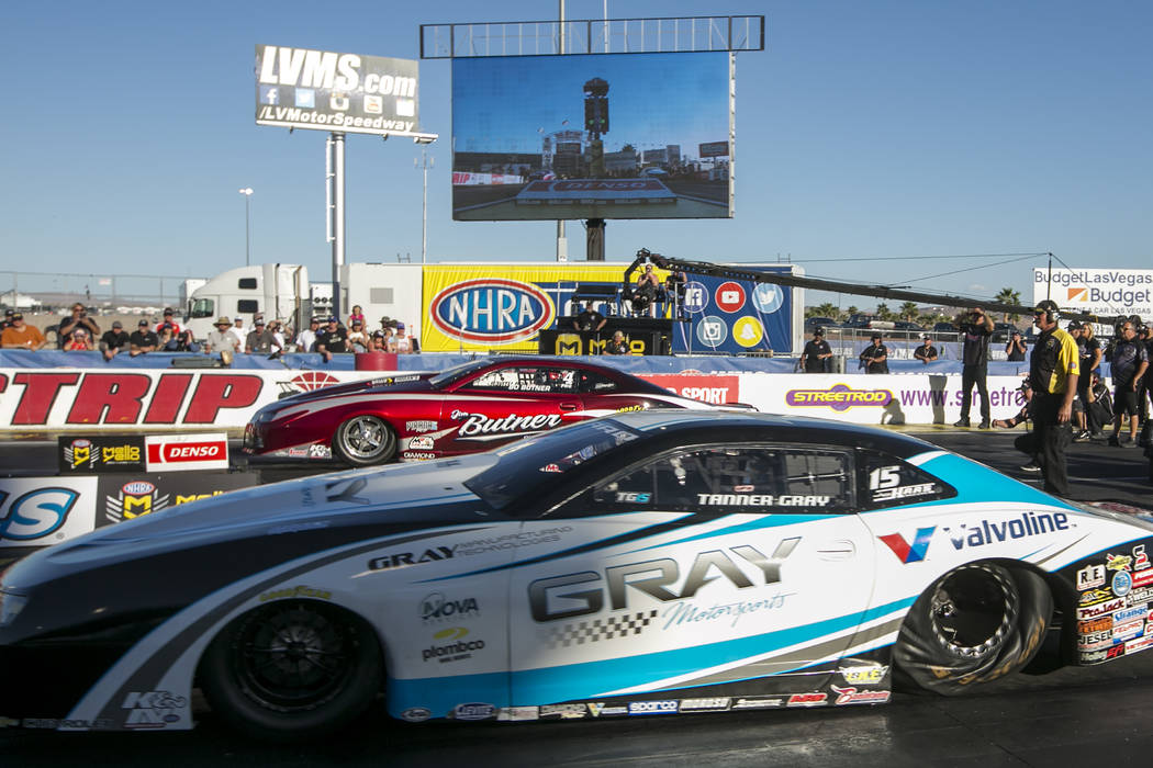 Pro Stock drivers Tanner Gray, front, and Bo Butner, back, go head to head at the final Pro Stock race at DENSO Spark Plugs NHRA Nationals at The Strip at Las Vegas Motor Speedway on Sunday, April ...