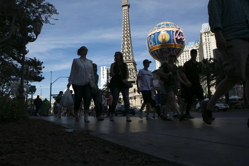 Pedestrians pass Paris Las Vegas' Eiffel Tower Experience on the Las Vegas Strip on Friday, March 17, 2017, in Las Vegas. (Bridget Bennett/Las Vegas Review-Journal) @bridgetkb
