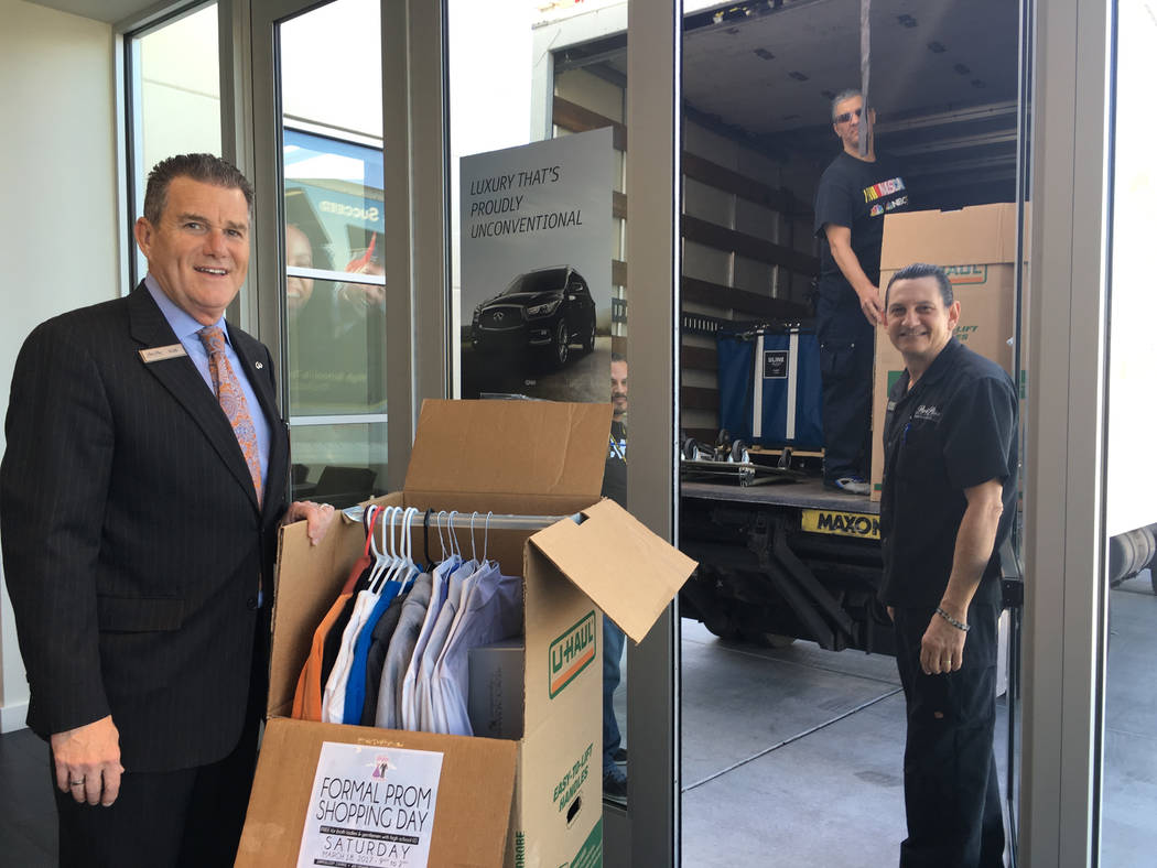 COURTESY Park Place Infiniti General Manager Rob Schweizer and lead valet Pedro Ponce load donations for the Las Vegas Prom Closet event. The March 18 event put on by nonprofit Project 150 and Zap ...